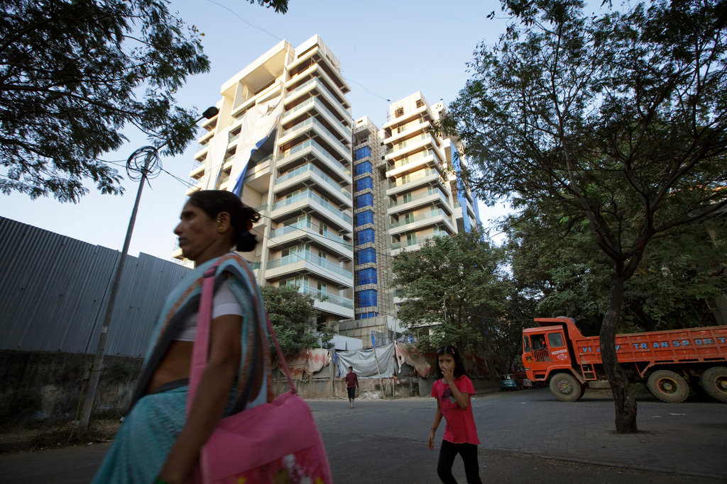 Why is Juhu preferred for buying luxury apartments in Mumbai? high-rise